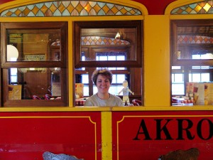 Eating lasagna on a trolley car